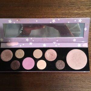 MAC makeup classic cutie eyeshadow palette.